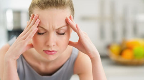 woman holding her head stressed