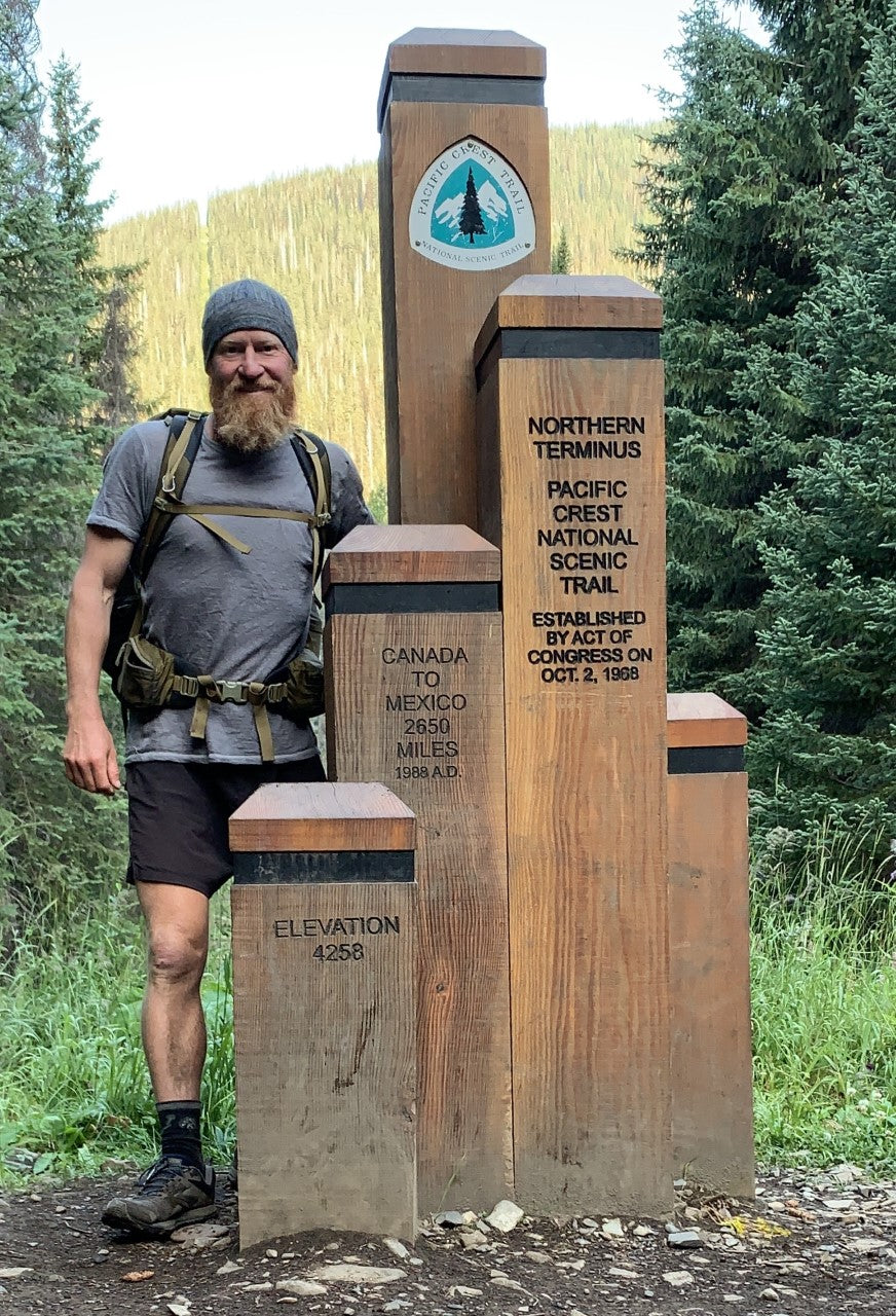 Ben at the northern terminus of the Pacific Crest Trail