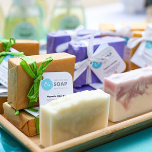 Organic Bar Soaps in wicker basket with bath towel