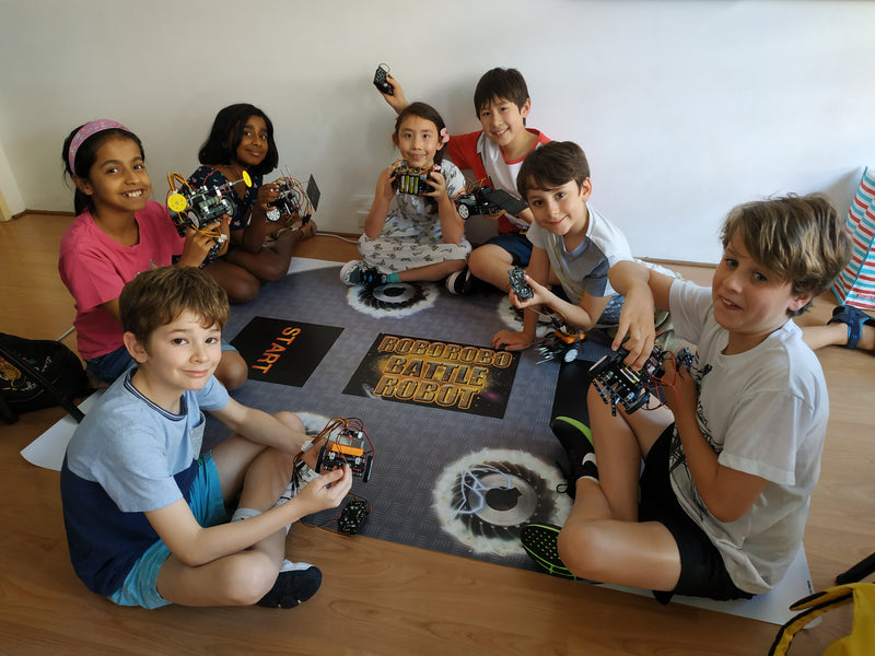 Robotics for kids help students learn collaboration and problem-solving as a team.