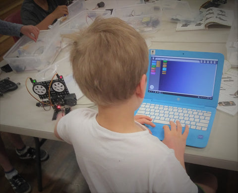 A student is coding a robot to complete robot challenge