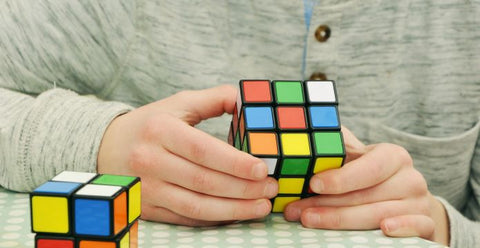 Kids learn how to solve rubik's cube on school holidays