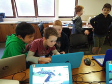 Load image into Gallery viewer, Boys are coding in Minecraft at Thinklum coding school holidays camp