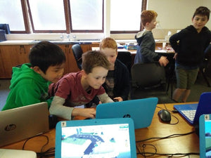 Boys are coding in Minecraft at Thinklum coding school holidays camp