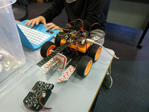thinklum student finishes programming challenge for his robot