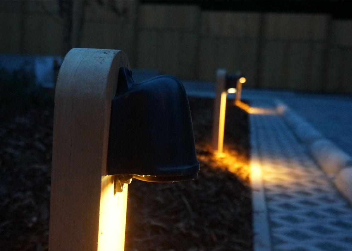 Authentage_balume on wooden pole_night_warm light outdoor garden light