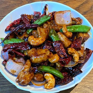 Wok-Fried Chicken Cubes With Cashew Nuts And Dried Chilli In Kong Po Style