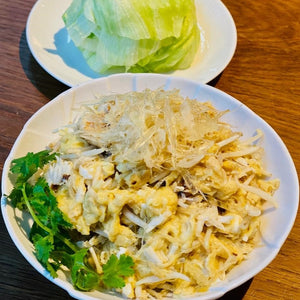 Scrambled Egg With Sautéed Shark's Fin And Crabmeat Served On Crispy Lettuce