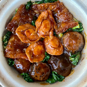 Braised Abalone With Mushroom And Fried Fish Maw Served In Claypot