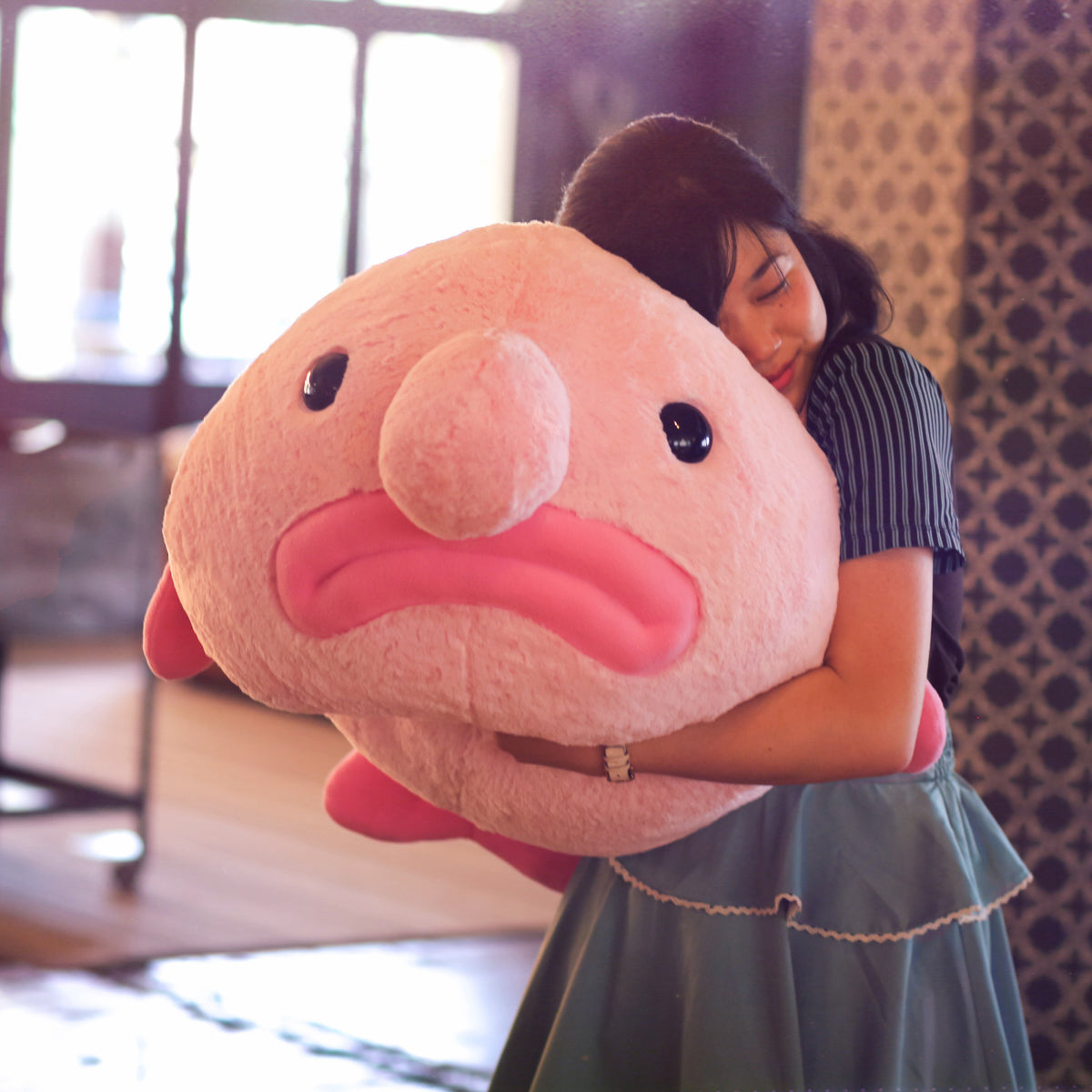 Huge blobfish with model