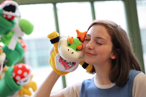A model snuggling our Bowser Jr. Puppet