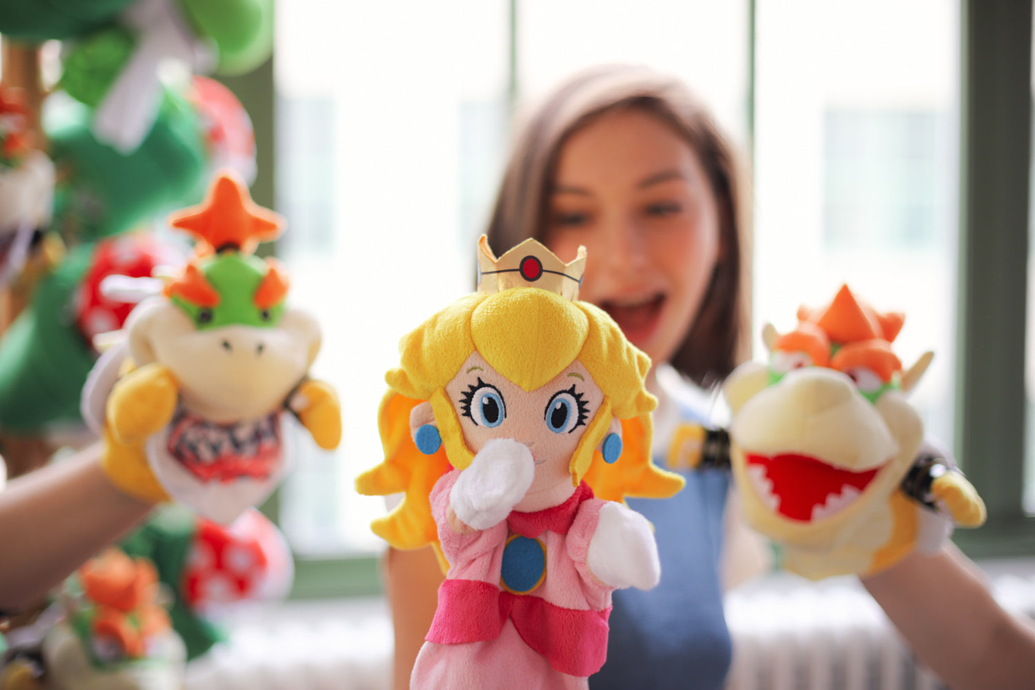 Licensed Super Mario hand puppets, by Uncute (from left to right: Bowser Jr., Princess Peach, and Bowser)