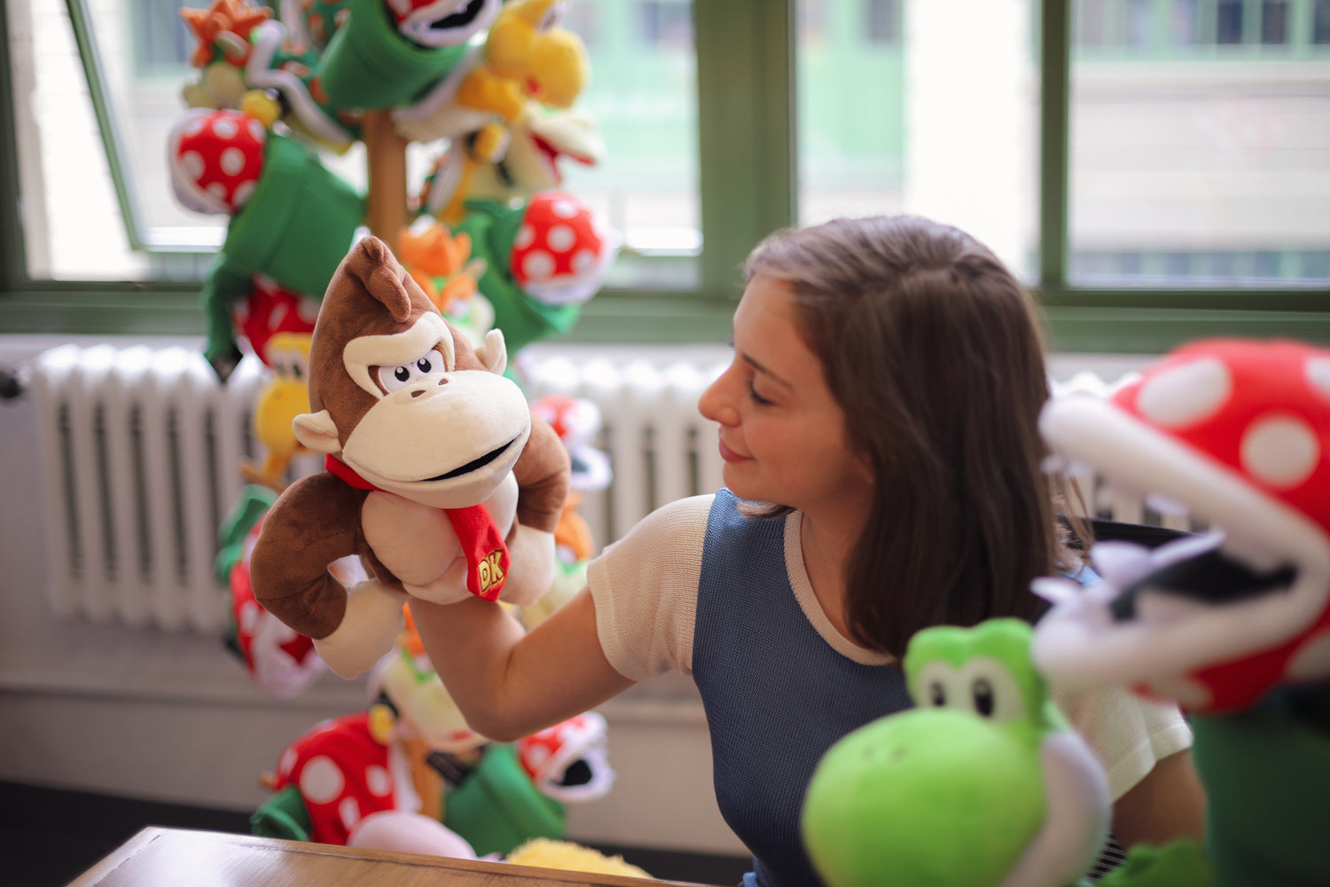 Donkey Kong puppet on model's armd