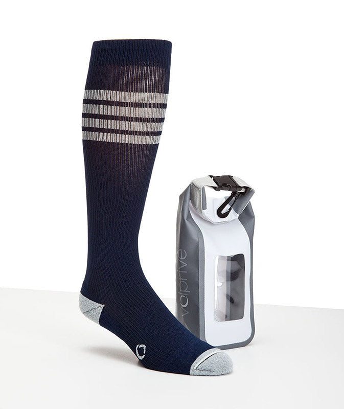 Medical grade compression socks.  Navy with 4 pale grey lines on the upper part.  With a reinforced pale grey heal and toe.  Shown with a grey and white 1.5L dry bag with a window.