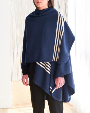 CHIC one size travel shawl.  Made with 100% soft Italian washable merino wool.  Marine blue with 4 beige stripes at the front bottom part.  Marine Milan collection.