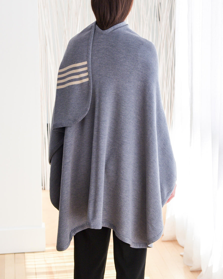 CHIC one size travel shawl.  Made with 100% soft Italian washable merino wool.  Medium grey with 4 beige stripes at the front bottom part.  Copenhagen Grey collection.  Back side shown.
