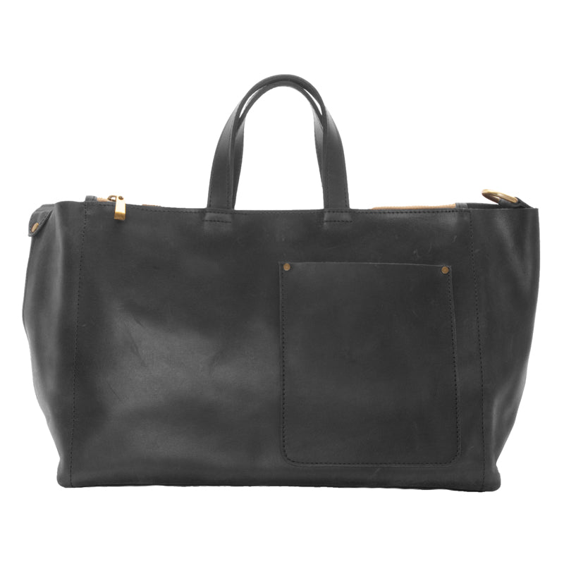 Stylishly elegant, flexible leather bag made of soft Ethiopian leather, perfect for everyday use or travel. Large, zippered compartments with outside pocket and key chain hook. 18 inches wide, 10 inches tall and 6 inches deep. Removable 1 inch wide strap, magnetic closure. Satchel color is black.