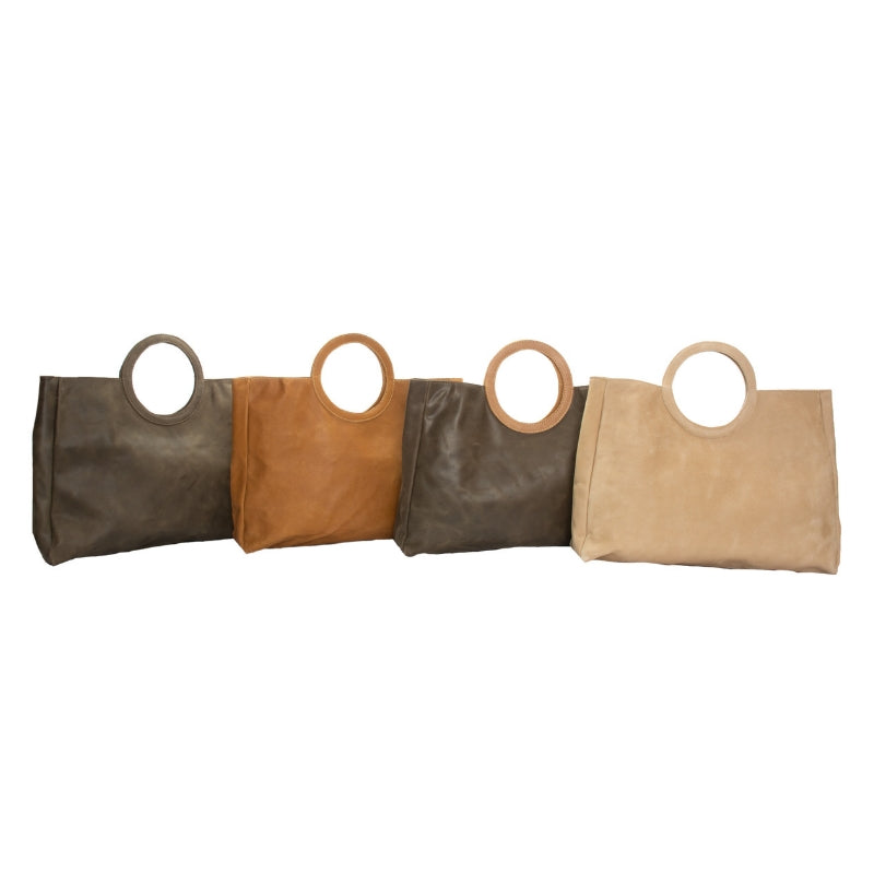 City Chic Circle Clutch is trendy and sleek. Handmade of full grain pull up Ethiopian leather by artisans in Ethiopia. 15 inches wide, 12 inches tall and 3 inches deep. Circular handles, dual magnetic closure, 1 open interior pocket. Holds your laptop for work or classic as an everyday purse.