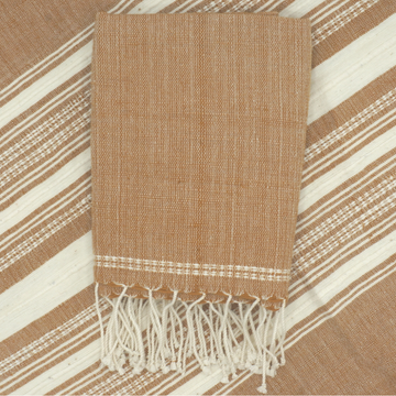This hand towel is intricately designed using traditional Ethiopian weaving techniques. The natural beauty of the hand loomed cotton  brings elegance to every style. 20 inches by 30 inches.  Your purchase benefits artisans living in Addis Ababa, Ethiopia.