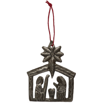 The Nativity Ornament displays the Christmas Story through the delicate artwork, hand-hammered by artisans in Haiti. Ornament comes pre-wrapped with a gift tag and red string hanger. 3.25 by 2.5 inches. Handmade from up-cycled steel drums