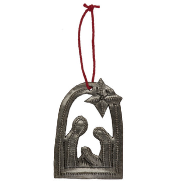 The Nativity Gift Tag is handmade in Haiti. Use as a gift tag or ornament to hang on your tree.Handmade from up-cycled steel drums. 2.75 by 2 inches.