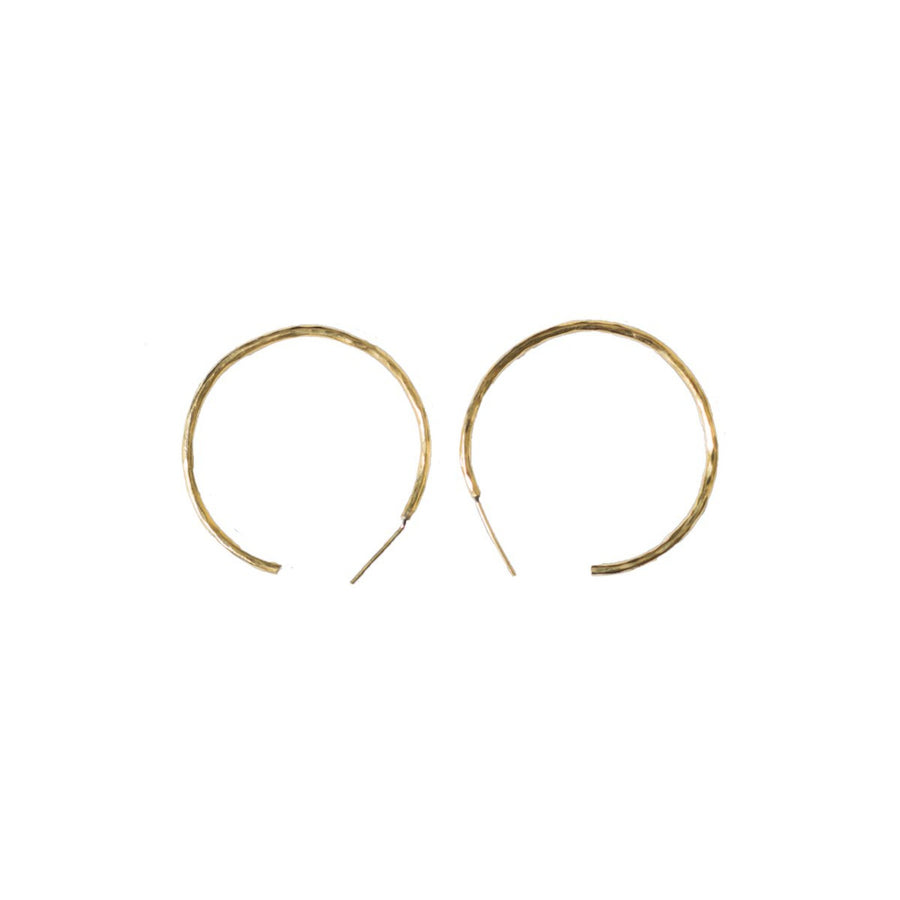 Hammered hoops medium are hand hammered and shaped brass, plated with 14K gold.  1.3 inches in diameter. Delicate and trendy hoops handmade by artisans in Kibera Kenya.