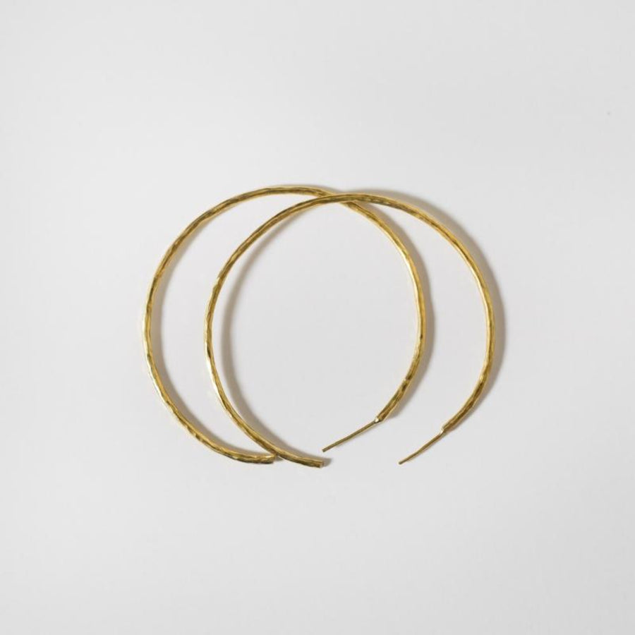 Hammered hoops large are hand hammered and shaped brass, plated with 14K gold. 2 inches in diameter. Delicate and trendy hoops handmade by artisans in Kibera Kenya