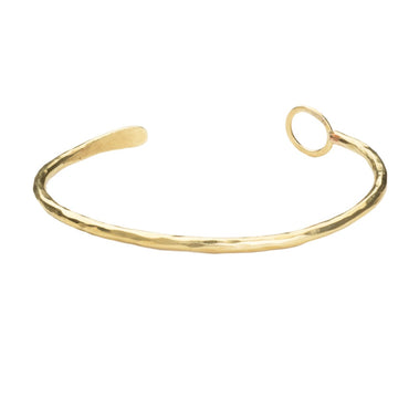 Classy and fun cuff with a .5 inch circle on one end. Handmade brass plated with 14K gold. Made with dignity in Kibera Kenya.