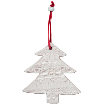 Ceramic Christmas Tree Ornament with a beautiful lace pattern baked into the white glaze. Tied with a red velvet ribbon and white ceramic bead. Each ornament comes wrapped with greenery and a gift tag. Handmade with dignity in Haiti. 4.5 by 4.25 inches. Perfect for giving as a gift