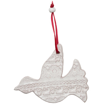 Ceramic Dove with a beautiful lace pattern baked into the white glaze. Tied with a red velvet ribbon and white ceramic bead. Each ornament comes wrapped and tagged. Handmade with dignity in Haiti. 4 by 5 inches. Perfect for giving as a gift.