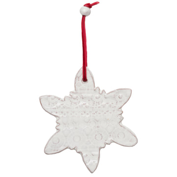 Ceramic Snowflake with a beautiful lace pattern baked into the white glaze. Tied with a red velvet ribbon and white ceramic bead. Each ornament comes wrapped with greenery and a gift tag. Handmade with dignity in Haiti. 4.5 by 4.5 inches. Perfect for giving as a gift.