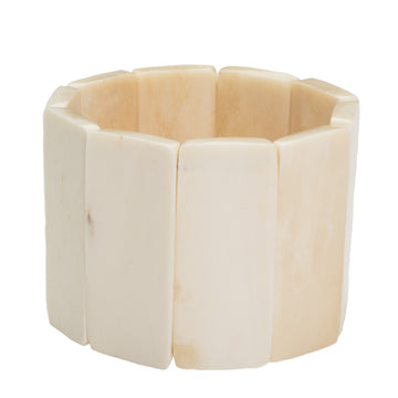 Ethically sourced bone bracelet, Polished rectangular shaped, ivory colored pieces made with an interior elastic band to fit any wrist. 1.75 inches tall. Handmade in Haiti
