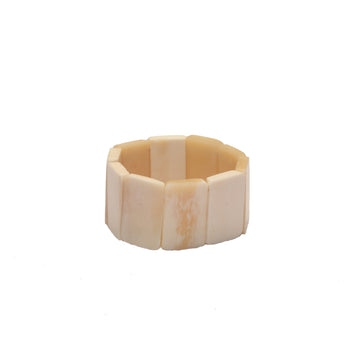 Ethically sourced bone bracelet, Polished rectangular shaped, ivory colored pieces made with an interior elastic band to fit any wrist. Hand made in Haiti