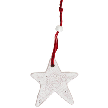 Ceramic Star with a beautiful lace pattern baked into the white glaze. Tied with a red velvet ribbon and white ceramic bead. Each ornament comes wrapped and tagged. Handmade with dignity in Haiti. 3 by 3 inches. Perfect for giving as a gift.