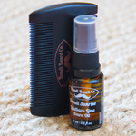Load image into Gallery viewer, image of small atomising vial of beard oil with a black two-sided comb, both with Bondi Beard Co. branding and sitting on a fibrous mat
