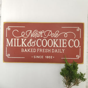 North pole Mike and cookie wood sign