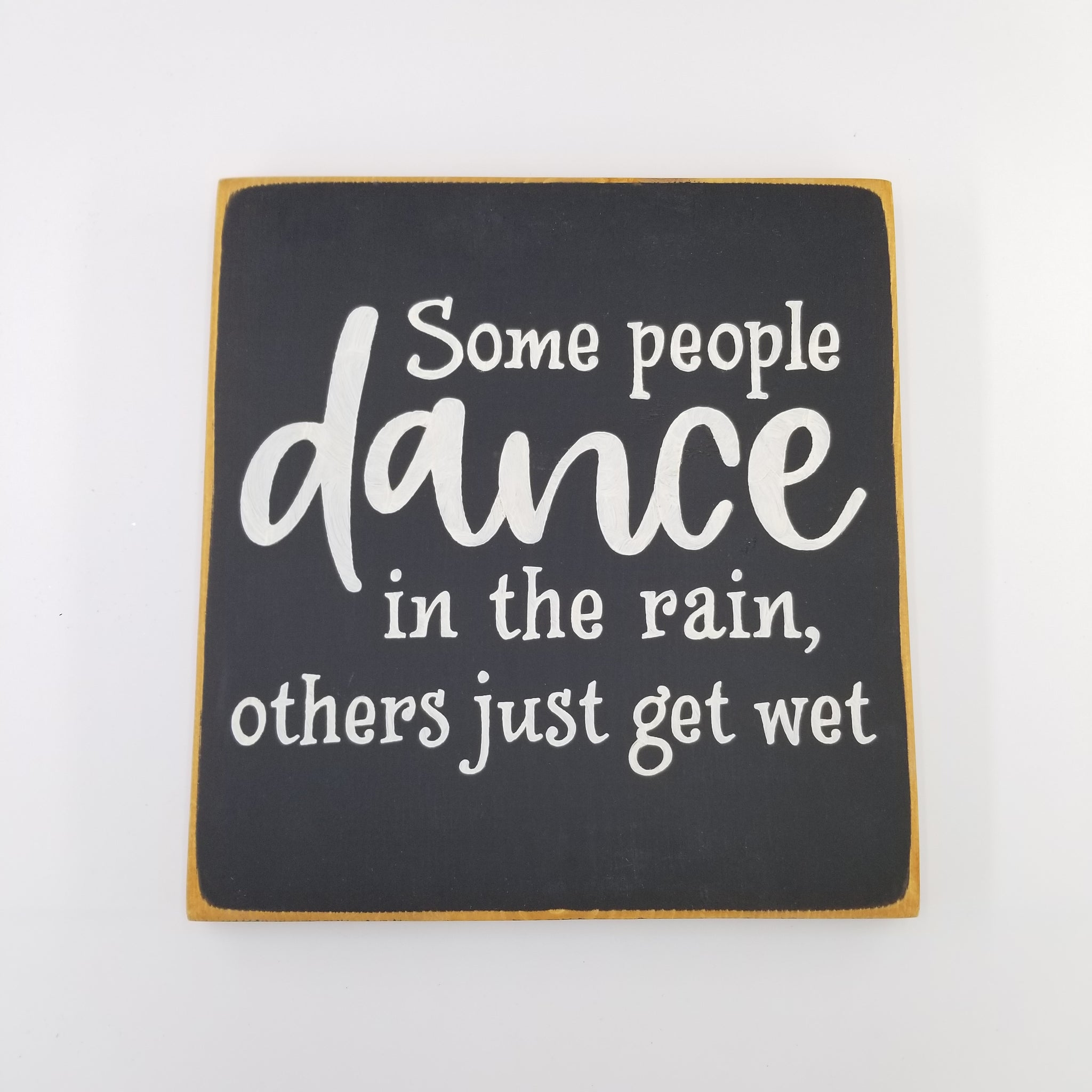 Some people dance in the rain and others just get wet wooden sign