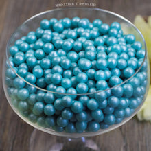 Load image into Gallery viewer, Lovely turquoise edible sugar pearls with shiny finish 7mm (approx)  Perfect to decorate cupcakes, a large cake, ice creams, smoothies, cookies.....the list is endless