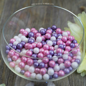 Lovely pink, purple and white edible sugar pearls with shiny finish 7mm (approx)  Perfect to decorate cupcakes, a large cake, ice creams, smoothies, cookies.....the list is endless  Packaged in sealed food safe bag