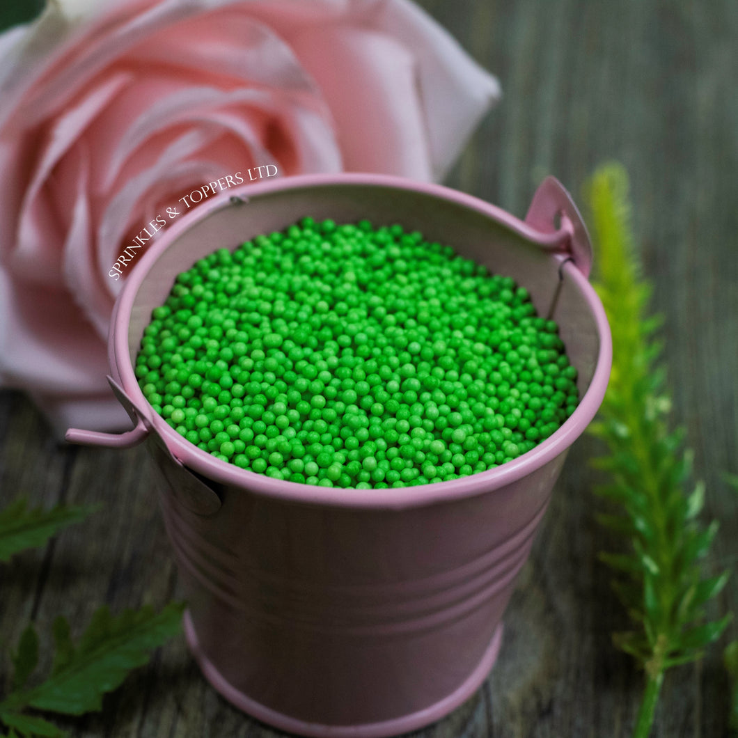 Green 100s & 1000s  These ever popular small sugar balls are perfect to top any cupcake, large cake, ice cream, shake and more...