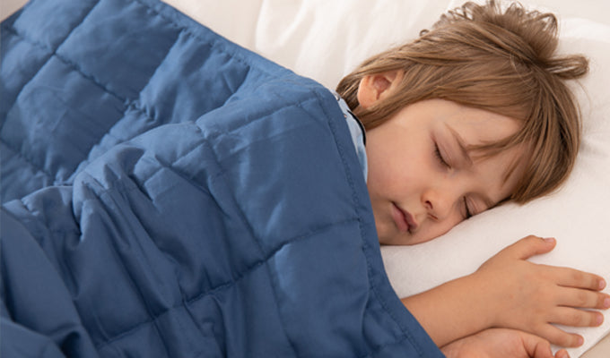 Boy Sleeping With A Blue YNM Weighted Blanket