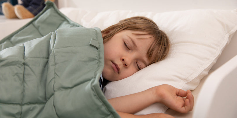 Boy Sleeping With Green YNM Weighted Blanket