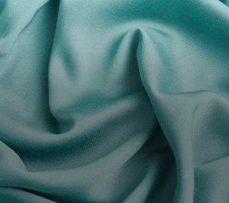 Close-Up Of A Creased Green YNM Weighted Blanket
