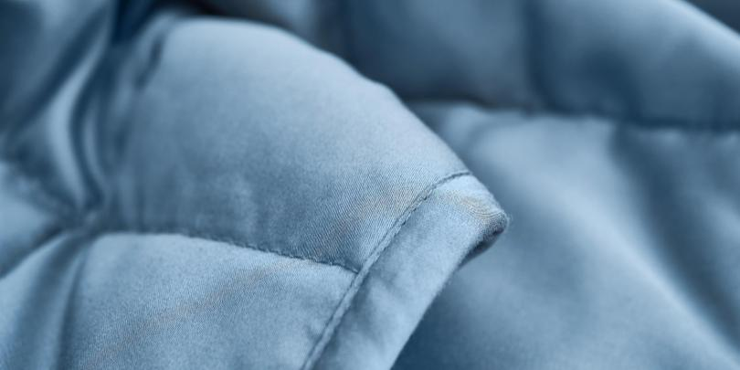 Woman Under YNM Infinite Minky weighted Blanket