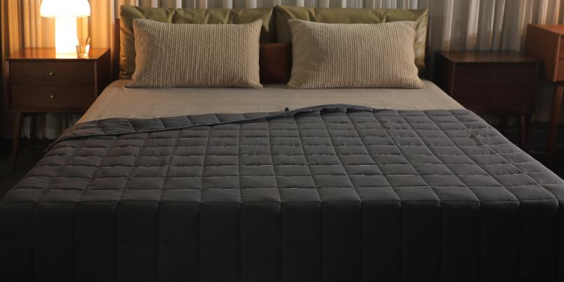 Dark Grey Couples Weighted Blanket On Bed