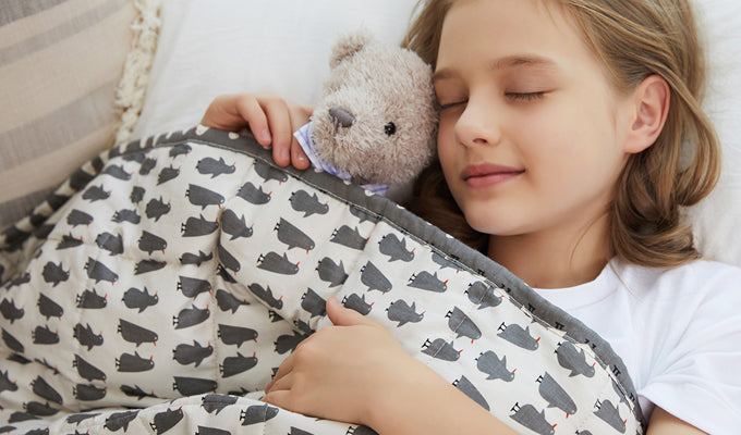 Girl In Bed Sleeping With Teddy And YNM Kids Weighted Blanket