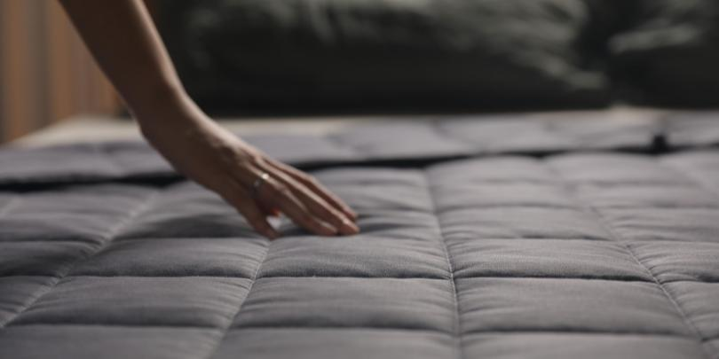 Hand Resting on Charcoal YNM Weighted Blanket