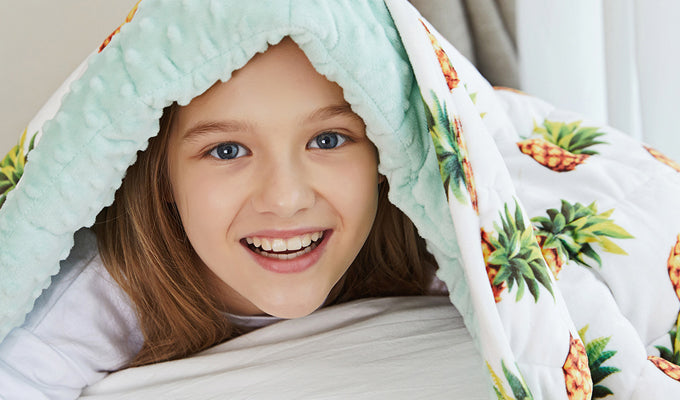 Kid Playing Under YNM Pineapple Weighted Blanket