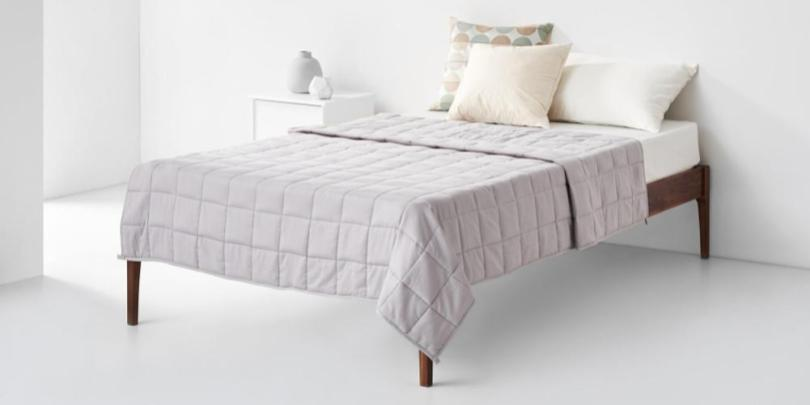 Pearl Weighted Blanket Neatly Folded on Bed