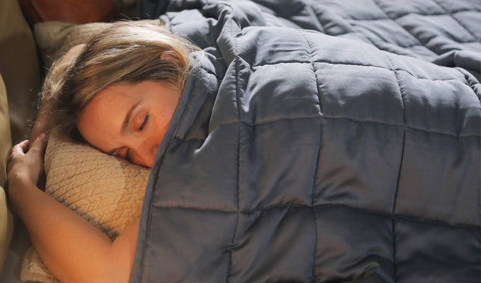 Woman In Bed Sleeping With Original YNM Weighted Blanket
